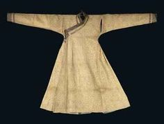 A MONGOL 'CLOTH OF GOLD' SILK AND METAL THREAD ROBE  CENTRAL ASIA, LATE 13TH OR 14TH CENTURY  Of silk woven with a very fine design of writhing dragons on a ground of dense floral designs, with long pleated flaring skirt, long tapering sleeves with applied bands of similar but contrasting silks forming the cuffs, similar panels of similar silks forming the collar bands, lilac silk ties, with original light blue silk lining.  54¾in. (139cm.) long; 82¼in. (209cm.) cuff to cuff