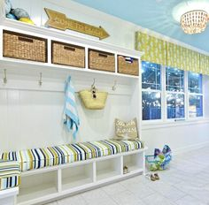 Coastal Beach Entry with Storage Bench, Striped Cushion and Wicker Baskets to Hide Stuff! And a Beach Sign, of Course!  Shop the Look at Completely Coastal: https://www.completely-coastal.com/2018/04/beach-cottage-decor-ideas.html