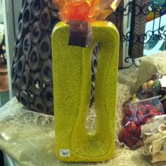 This fun and funky 'amoeba' vase adds a splash of fall color! Find  it in the Garden Shop, $155.