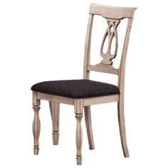 Side chair with a seat cushion and turned front legs. Product: ChairConstruction Material: WoodColor:
