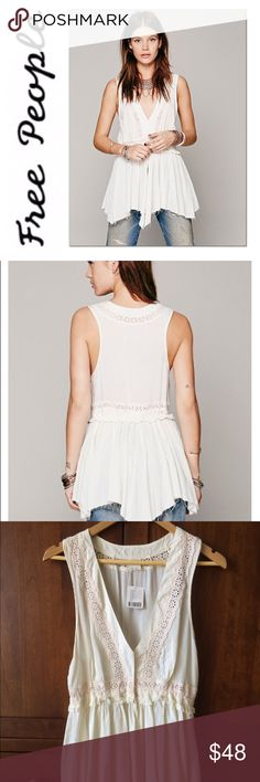 """💫 Free People ivory Eyelet Tunic tank Romantic and edgy. An ivory tunic is decked out with eyelet, smocked waist, deep armholes, hook and eye closure, flowy uneven raw edge hem. Listed as white or cream to make it easier for people to find it. The best color description is ivory. Looks great with leather pants/leggings. Never worn. NWT.  100% rayon, cotton trim.  17"""" pit to pit 28"""" back of neck to bottom Free People Tops"""