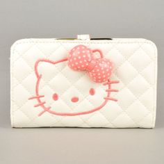 Cute white Hello Kitty wallet http://www.welovekitty.com/hello-kitty-wallets/
