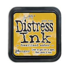 """April Distress Ink Pad - Fossilised Amber <br />• Acid free <br />• Non-toxic <br />• Fade Resistant <br />• New Higher Felt Raised 2"""" x 2"""" Pads <br />• Water-based Dye Inks <br /> <br />Fossilized Amber– a rich, warm golden hue. This new <br />buttery yellow has a slightly muddy undertone%..."""