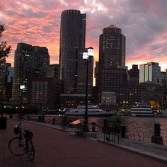 Boston Bikes at Night: During one of the most unique bike tours in Boston, you'll enjoy the beautiful waterfront as the sun sets, and explore some of the city's best sites as the night begins to fall! #Boston #BikeTour