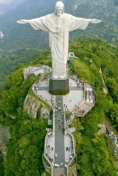 """Christ the Redeemer""  sculpture in Rio de Janeiro, Brazil.  Dedicated October 12, 1931 and completed October 12, 2006.  Sits at the peak of Corcovado Mtn. in Tijuca National Forest Park.  Construction took nine years from 1922 to 1931.  It weighs 635 tons and is 2300 ft high. A symbol of Brazilian Christianity, the statue has become an icon for Rio de Janeiro and Brazil. It is made of reinforced concrete and soapstone."