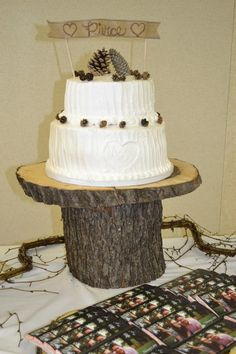 rustic wedding cake banner winter wedding wood log cake stand burlap banner....LOVE the pinecones!!