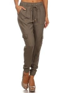 Solid, full length skinny pants with a waist tie and pockets SHELL:100% RAYON, 100% POLYESTER MADE IN CHINA