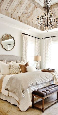 We're dealing with an all neutral space here that gives the room a very calm and relaxing feel. Browns, whites, creams, some grays, and touches of gold all blend together to create a warm and inviting feel. I usually love a pop of color in a space to add some life, but this room doesn't really need it. The rich brown tones of the bed pillow, basket, and coverlet add that color that my eye is always searching for.