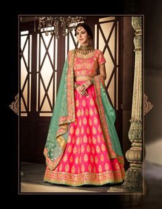 Online Shopping of Embroidered Rani Bridal Lehenga In Dhupion Fabric with Designer Choli from SareesBazaar, leading online ethnic clothing store offering latest collection of sarees, salwar suits, lehengas & kurtis Pink Lehenga, Bridal Lehenga Choli, Indian Lehenga, Banarasi Lehenga, Lehenga Blouse, Anarkali, Indian Dresses, Indian Outfits, Indian Clothes