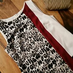 Beautiful Color Block Ann Taylor Leopard, Burgandy, and Cream color Sheath. Back is Cream, Burgandy and Black blocks. Bust 18 in. Waist 18 in. Hips 20 in. Length underarm to hem 28 in. 69% poly, 28% rayon and 3% spandex. Cream liner in 100% poly. Rear zipper with hook and eye. Ann Taylor Dresses