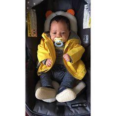 Tiny person in a tiny raincoat!!