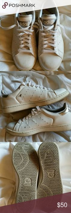 Adidas White Low top Leather Sneakers Stan Smith style, Low profile, iconic court shoe; all white with silver Adidas logo on heel. In excellent condition other than the small spots of brown paint shown in 2nd pic. It may come off but I haven't tried. Only worn a couple times because they were to big. Great classic sneaker that will never go out of style. Unisex:-  Men's 5.5. Women's 7.5 Adidas Shoes Sneakers