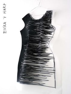 Designer: Elvira 't Hart - a recent fashion graduate who translates 2D sketches to 3D garments
