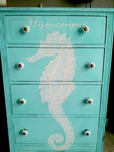 her gorgeous Hand Painted Beachy Dresser. First, she painted the dresser with a coat of blue chalk paint. Then, she projected the Seahorse image onto