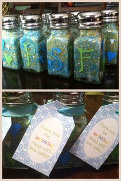 Baby sprinkle favors - Dollar store salt and pepper shakers decorated with sharpie oil paint marker in hearts and baby's initials. Filled with colored sugar sprinkles (I mixed my own color combo by buying white, blue and yellow, mixing it together in a big bowl and filling each shaker using a funnel). DIY printable tags from craft store tied on with a ribbon. Cute and festive without breaking the bank!