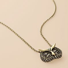Owl necklace made of antiqued brass-tone and clear crystal pavé, crystals.