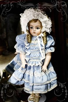 This is a French Bru reproduction porcaline doll made by me. Outfit was also made by me.