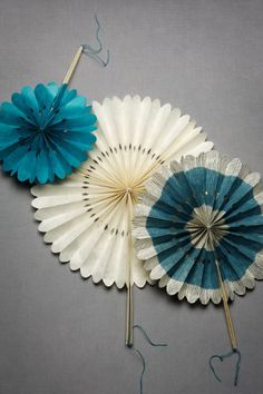 Layer colors and patterns by tucking these hand-crinkled and clipped wheels into centerpieces and tablescapes, hanging them from the ceiling, or pinning them onto walls.