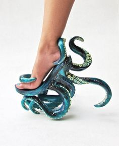 Totally insane-looking—and probably not practicable footwear—tentacle high-heeled shoes made by fashion designer, costume designer and shoe designer Kermit Tesoro. I can't imagine walking in these. Hell, I can't even walk in heels to begin with!  I just checked out Kermit Tesoro's Facebook page to see if he had any other equally freaky high-heeled designs and it looks like he's also got a Venus flytrap shoe. Why not? Again, probably totally impractical unless you're Lady Gaga or a Japanes...