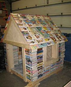 "This is a reading ""house"" for kids made out of discarded books. What a cute idea for a children's room at the library. And libraries are great places of No Regrets Parenting."