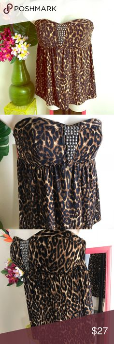 Torrid strapless cheetah fit and flair top size 14 This is a great cheetah leopard print top featuring is significant Bustier trimmed and studs with a flowing waste to teach play the positive and hide the negative which is one of the things I love about torrid! Size 1 is equivalent to a size 14.  top is in excellent preowned condition ! Save money when you bundle purchase from my closet torrid Tops