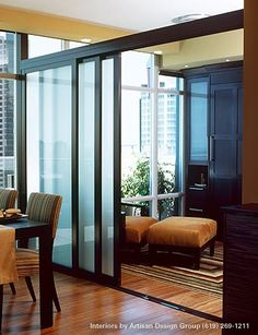 stackable sliding doors to delineate rooms. These frosted glass doors can make the space feel large and open, but can be closed for the room to be used as a guest room. Perfect solution if you own a studio apartment.
