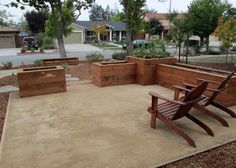Decomposed granite patio is a very smooth and hard surface that drains well.  Shown here with redwood raised boxes for plantings and to define the space.