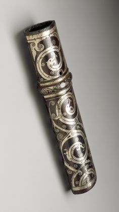 "300-100 BCE. Bronze  Weapon Shaft Grip  with inlaid silver of interlaced dragons. , 6 5/8"". China.  LACMA."