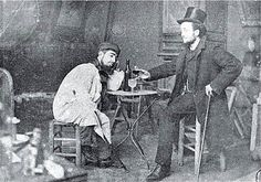 Toulouse-Lautrec (left) and fellow poster  artist, Lucien Metivet, drinking absinthe, 1895.