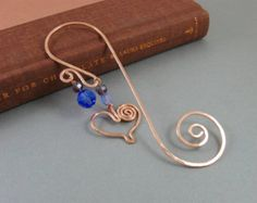 Swirly copper wire bookmark with copper wire heart charm and blue Swarovski crystal bead accents