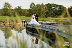 The bride & groom taking a stroll on the bride along the green. Photo Credit - Dave Bigler Productions