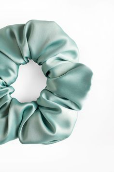 "Mint - Satin Scrunchie  Handmade Item  This listing is for one scrunchie.  Receive a discount when you order 3 Scrunchies! Use the code ""SETOF3"" at checkout.  Every scrunchie is handmade by us in Alberta, Canada. These can be wrapped around your hair once, or multiple times depending on the thickness of your hair. Scrunchies, Handmade Accessories, Handmade Items, Bridal Shower Favours, Mint Hair, Birthday Party Favors, Your Hair, Alberta Canada, Satin"