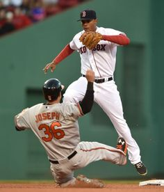 Red Sox shortstop Xander Bogaerts, top, leaps over Baltimore Orioles' Caleb Joseph after stepping on the bag to get Joseph out to end the eighth inning of a baseball game, Saturday, April 18, 2015, in Boston. (AP Photo/Gretchen Ertl)  Boston Red Sox Team Photos - ESPN