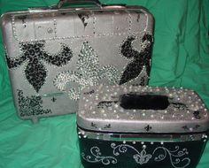 Vintage suitcases are easily found at thrift shops snd painted with acrylic paint.  Embellishments stick with hot glue.