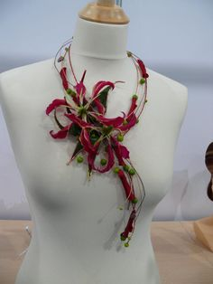 gorgeous!! - floral necklace made with gloriosa lilies.