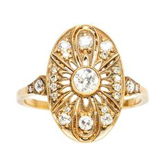 Trumpet & Horn Diamond Gold Engagement Ring | From a unique collection of vintage engagement rings at http://www.1stdibs.com/jewelry/rings/engagement-rings/