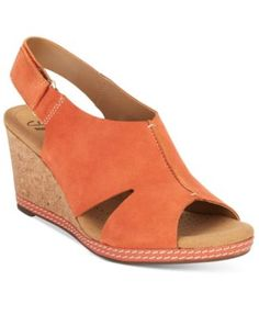 Clarks Collection Women's Helio Float Wedge Open-Toe Sandals $69.99 A pretty, feminine silhouette defines the stylish peep-toe Helio Float sandals from Clarks Collection.