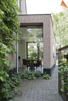raam in leistenen muur interieur-design-huizen-kraal-interieur-architecten-04