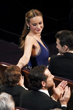 Jacob Tremblay high-fives Brie Larson in the audience at the Oscars on Sunday, Feb. 28, 2016, at the Dolby Theatre in Los Angeles.