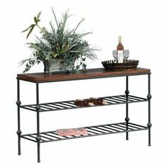 """Gunmetal console table with 2 open slatted shelves.  Product: Console tableConstruction Material: Gunmetal and veneersColor: Antique tobaccoFeatures: Two shelvesDimensions: 30"""" H x 50"""" W x 18"""" D"""