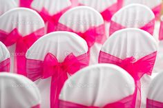 hot pink wedding chairs. Do a his and her side for colors!