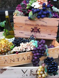 Wine tasting party decorating with grapes and wine boxes. www.alltheragedecor.com