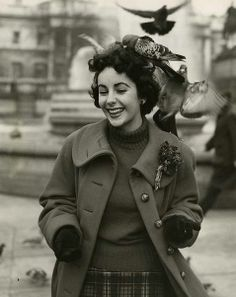 Elizabeth Taylor feeding pigeons in Trafalgar Square, London -- 1948