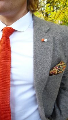 Knot cuff-links, pushed through lapel buttonhole for added color.   Typically, these are fairly inexpensive and look neat.   ~Guy
