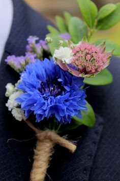 Natural cornflower blue buttonhole.  Photograph by courtesy of Liz Ewbank http://raddingsphotography.wordpress.com/