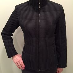 Black fitted jacket Soft, quilted jacket made by Postmark Italy. US size 6. High neck, zipper front, 2 outside zipper pockets and one inside zipper pocket. Beautiful jacket purchased in Vail, CO and rarely worn. Postcard Jackets & Coats