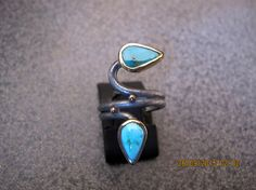 Turquoise Oxidized Sterling Silver and 8 carats Gold Ring