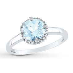 Round diamonds orbit a round natural aquamarine to create a design that is clean and breathtaking in this must-have ring for her. The ring is styled in 10K white gold and has a total diamond weight of 1/20 carat. Diamond Total Carat Weight may range from .04 - .06 carats.  Gently clean by rinsing in warm water and drying with a soft cloth.