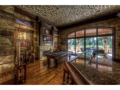 I love this rustic game room/bar in this Quail Creek home in Naples, FL.