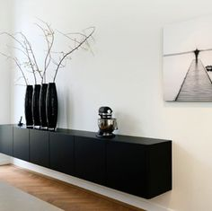 Designed to offer contemporary style, this amazing dark coloured sideboard helps connect the kitchen to the living area. #Poggenpohl #kitchen #living #sideboard